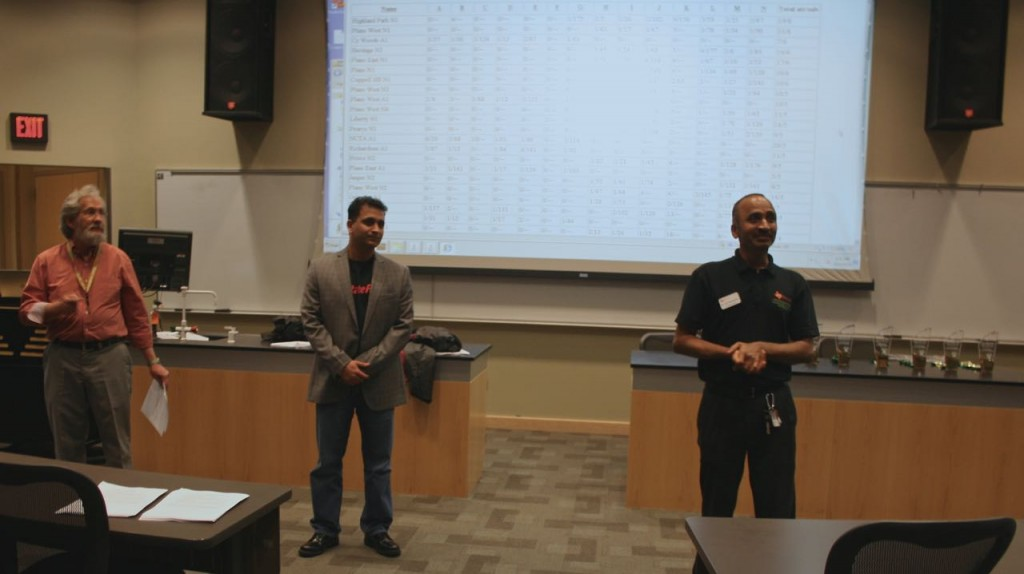 Dr. Jey Veerasamy, Sachin Buche, a Senior Executive from State Farm Insurance, and Dr. Ivor Page speaking to the students about the importance of Computer Science.