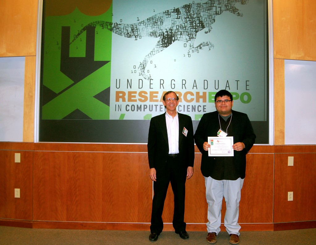 Prof. John Cole and 1st place winner in the poster presentations, Stephen Pena from the University of Houston