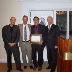 Eric Wong (third from left) receiving his Engineer of the Year Award from Jeff Voas, Christina Hansen, and Dennis Hoffman