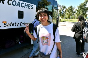 Shiva Sharma, CS Undergrad, loading her bags onto the bus.
