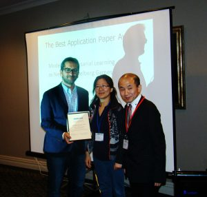 Drs. Kantarcioglu and Zhou receiving the award for Best Application Paper at PAKDD'16.
